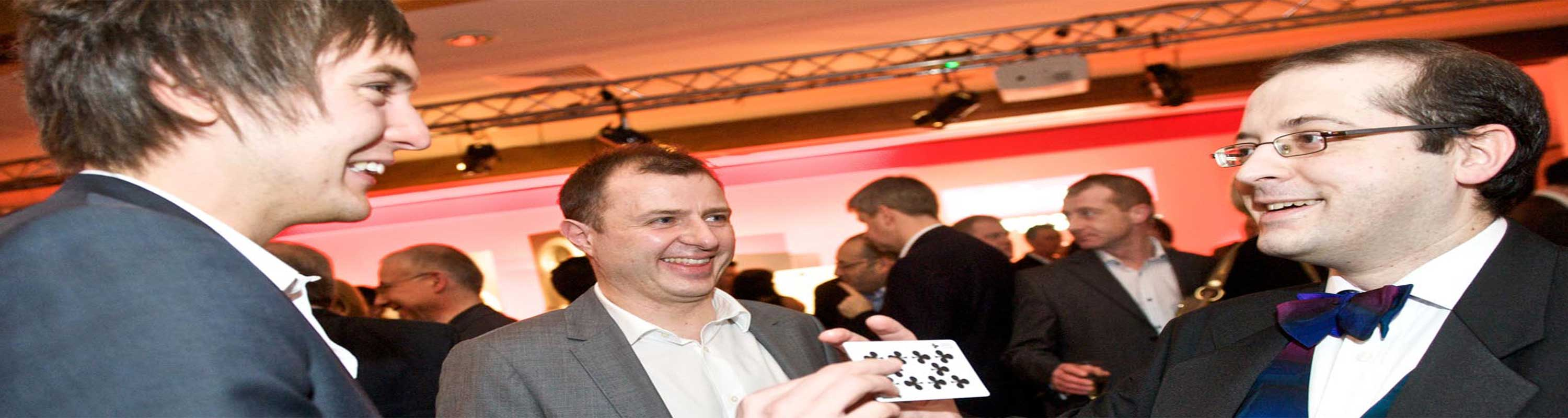Marco performing card magic at a company event.skilled magician to enhance party